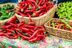 Red hot peppers in baskets Royalty Free Stock Image