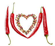 Red hot peppers in pods and mixture of peppercorns Royalty Free Stock Photos