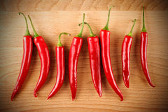 Red hot peppers on wood board Stock Photography