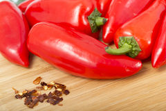 Red hot peppers on wooden cutting board. Stock Photography