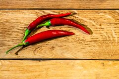 Red hot peppers on wooden table