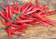 Red hot peppers on wooden table at  market Stock Photos