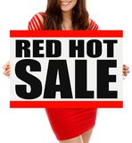 Red Hot Sale. A woman holding a sign indicating  Red Hot Sale Royalty Free Stock Photos