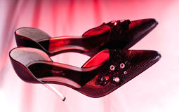 Red hot shoes and black shoe Stock Image