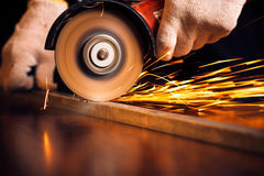 Red hot sparks at grinding steel material Royalty Free Stock Image
