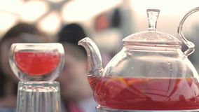 Red hot tea in a cup and teapot. HD stock footage