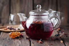 Red hot tea on the wooden table Royalty Free Stock Photography