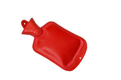 Red hot water bottle with hot water. Image isolated on white studio background Royalty Free Stock Images