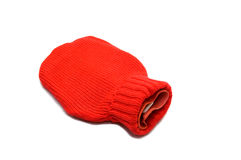 Red hot water bottle made of rubber and woven Stock Photo