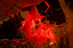 Red hot wood embers detail in fire place Stock Image