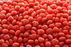 Red Hots. Cinnamon candies in a display case Royalty Free Stock Image
