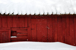 Red house. A red house in-bedded in snow Stock Photo