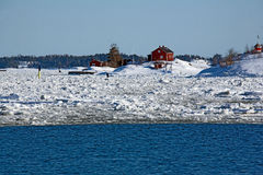 Red house. On the island. Open water in winter Stock Photography