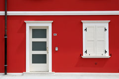 Red house. In front of new red house with white door and window royalty free stock image