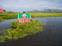 Red house. Aerial view of miniature norwegian house on lake stock images
