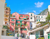 The red house. AMALFI, ITALY - OCTOBER 5, 2012: The red house  with the through passage, going up to the mountains, on October 5 in Amalfi Royalty Free Stock Image