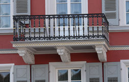 Red House Balcony. This 19th century cast iron balcony can be found on a red house in the Palatine area of Germany Stock Photography