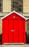 Red house on the beach, colorful door to summer cottages, seasid Stock Photography