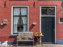 Red house with a bench Stock Photography