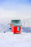 Red house and cable road, ski resort Tzahkadzor, Armenia Royalty Free Stock Photography