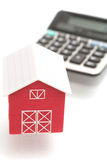 The red house and the calculator. On a white background Royalty Free Stock Image