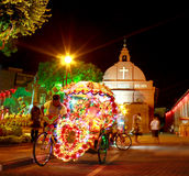 Red house Christ Church in Malacca. Night scene of Christ Church Melaka with tricycle. This is the landmark of Malacca, Malaysia Stock Images