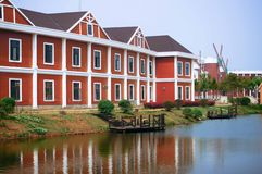 Red House. Clean tall red building at the river side showed a beautiful and nice Stock Images