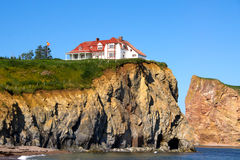 The Red House on cliff Royalty Free Stock Photography