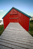 Red house with footbridge Royalty Free Stock Photo