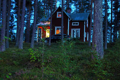 Red house. In the forest at night Stock Images