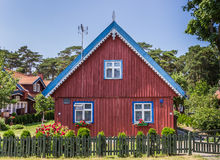 Red house with green fence Royalty Free Stock Images