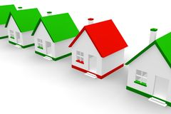 Red house within green ones Stock Images
