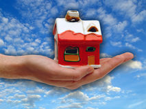 The red house in the Human hand Royalty Free Stock Photos