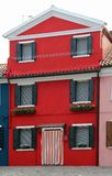 Red house on the island of Burano near VENICE in Italy Royalty Free Stock Image