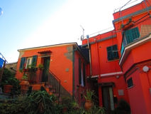Red house in Italian village Royalty Free Stock Image