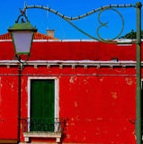 The red house and lamp Royalty Free Stock Images