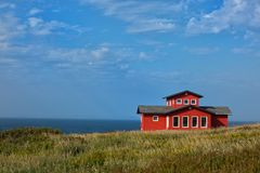Red house in a land Stock Photo