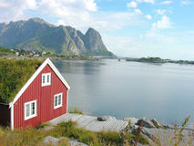 Red house in Lofoten. Red house by the see in Lofotn Islands Stock Images