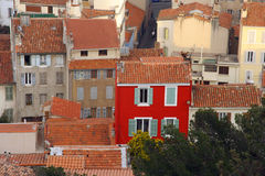 Red house marseille. A red house stands out against the background in marseille view stock image