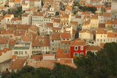 Red house marseille. A red house stands out amongst the view in marseille stock photography