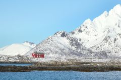 Red house mirroring in the Trollfjord Royalty Free Stock Photography