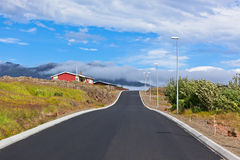 Red House and New Asphalt Road in East Iceland Stock Photography