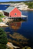 Red house on the peggy'cove Royalty Free Stock Image
