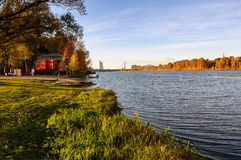 Red house of rescue station and coastline of river Daugava in Riga, Latvia Royalty Free Stock Photo