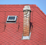 Red house roof with smoke stack Stock Photos