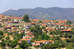 Red house roofs of Mediterranean village Stock Images