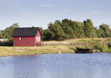 Red House by Rowing Boats Royalty Free Stock Photo