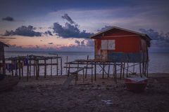 The red house. Shot of a wooden red house built on stilts taken at Denawan Island, Sabah Malaysia Royalty Free Stock Photo