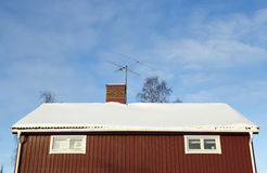 Red House With Snow on the Roof Royalty Free Stock Photography