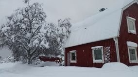 Red house in snow Royalty Free Stock Photos